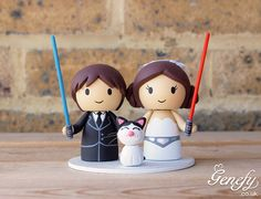 Hans Solo groom and Princess Leia bride with cat wedding cake topper https://www.facebook.com/genefyplayground