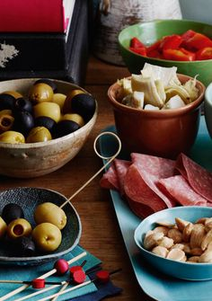 An assortment of Thanksgiving Tapas like Cheese, Olives, Charcuterie and marinated veggies that make for the perfect pre-Thanksgiving platter of nibbles!