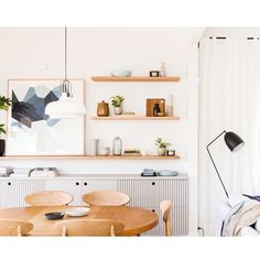 Our dining room in Northcote  by @bicker_design  Art: @theartworkstylist  Wall light: @beaconlighting  Floating Shelves: @cameronconstruction  Dining Chairs: @curious_grace  Table: @grandfathersaxe  Plants: @looseleaf__  @lizzyallnutt  #RenoRumble #Northcote #teamwork @kyalandkara @aydenandjess