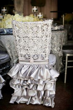 Ruffled Silver Chair Cover  Photography: Kevin Beasley Photographer Read More: http://www.insideweddings.com/weddings/opulent-wedding-with-gatsby-inspired-theme-at-louisiana-plantation/747/