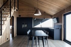 Inside, the cabin is arranged around an open living area with a living room, kitchen, and dining area Secluded Cabin, Light Hardwood Floors, Open Living Area, Little Cabin, Wooden Cabins, Attic Spaces, House And Home Magazine, Sliding Glass Door, Oslo