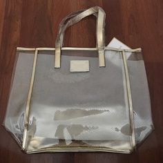 Brand New MK clear and gold tote Brand new. Never used. MK Clear and gold tote. NO TRADES Michael Kors Bags Totes
