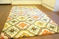 "make a bigger rug by sewing a few smaller rugs together! Great for odd sized areas or that ""perfect"" rug that only comes in a door mat size."