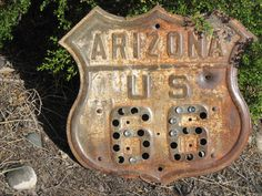 very old Rt.66 sign with a few remaining cats eyes