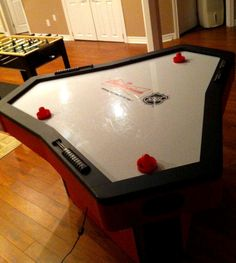"""3-player air hockey table. I'm not sure 3-player air hockey is an official """"thing"""" yet. It seems to be in it's infancy in terms of shape and size of the table. I love the idea, but the ones I've seen seem too small. Either the distance between players feels cramped or the area around each goal seems too small. Taking air hockey to the next level may involve an extra player, but it also has to go BIG!"""