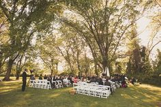 Wedding Ceremony in Front of Large Tree next to Reception Tent at Woodlawn Manor - Sandy Spring, MD - Montgomery Parks Wedding Venue