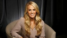 """FILE - In this Sept. 28, 2015, file photo, Carrie Underwood poses for a portrait at Sony Music Nashville in Nashville, Tenn., to promote her latest album, """"Storyteller."""" ABC announced Wednesday, Oct. 28, 2015, that the country star will perform a number of her hits during """"Dick Clark's New Year's Rockin' Eve with Ryan Seacrest"""" in New York City's Times Square. The special, which airs live, starts at 8 p.m. EDT. (Photo by Donn Jones/Invision/AP, File)"""