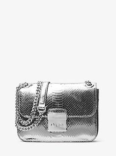 Giving looks a glam boost has never been easier—or more sophisticated—than with our smartly structured Sloan Editor shoulder bag. Crafted from metallic snakeskin, the look and feel of this design is modern in its metallic finish and wild in its texture.