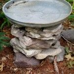 stacked stone bird baths, outdoor living, repurposing upcycling, When the stacked stone is the height desired add the galvanized lid One down and two more to go