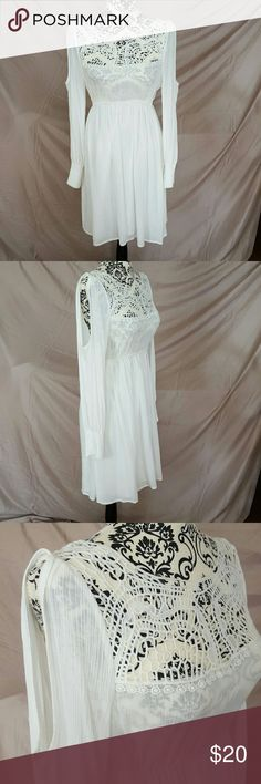 """White Crochet Cold Shoulder Boho Dress Brand new with tags! The dress is pure white with crochet detailing on the chest. Elastic waist. The sleeves have elastic at the bottom with an open shoulder. The top is unlined and the bottom has a light, cotton lining. Soft and light gauze material.   ??Measurements (laying flat, unstretched) Bust-16.5"""" Waist-13"""" Length-35"""" Breeze Ever Dresses Mini"""