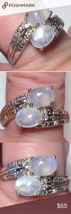 NWT GENUINE Rainbow Moonstone/ + Diamonds 925 Ring Size 9 Brand New! Platinum/.925 Sterling Silver (nickel free ) fine Sterling Silver.  GENUINE  Naturally Mined Sri Lankan Rainbow Moonstone (2- oval cabochons) with awesome fires and rainbows of colors- + 2 diamond fancy faceted rounds and other diamond accents down both sides is the ring setting shoulders.  ring has a completed undergallery to protect the stones. This ring lists at MSRP: $199.98 Bought from a USA based Jeweler .   💕💕Comes…