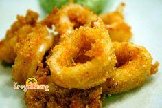 Les calmars frits épicés sont un apéritif délicieux que vous avez probablement essayé dans un restaurant, mais c'est aussi très facile à faire à la maison.
