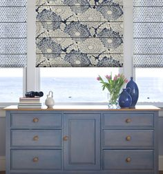 Don't be afraid to combine patterns, colors, and textures in your home. Design your very own Roman Shade for your eclectic cottage chic style.