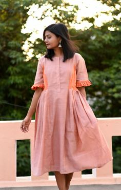 Color blocked beige orange Khadi muslin dress with side pleats and sleeves. A minimal, comforatble dress which is easy to carry with the right style quotient. Kurti Neck Designs, Kurta Designs Women, Salwar Designs, Sleeve Designs, Stylish Dresses, Casual Dresses, Short Dresses, Summer Dresses, Blue Midi Dress