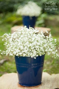 Navy buckets with white baby's breath for aisle decoration