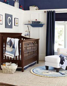 Boys Nursery navy top, white paneling, brown crib?
