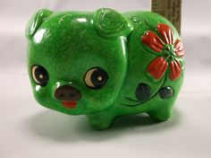 "Vintage mod pig Bank 1960 s Green And Red. Approx 2-3/4"" in height, approx. 3 1/2"" long , 2 1/2"" wide at widest point. . There are signs of age/use/wear. Some color/enamel fade/loss in areas."
