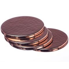 Just Slate Set Of 4 Copper Coasters: These beautiful, hand-beaten coasters will add an elegant finish to your dinner or coffee table.