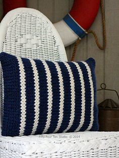 """Line Up Pillow"" knitting pattern by Fifty Four Ten Studio.  Knit with super bulky yarn.  Quick and easy.  #Stripes  Click for more details."