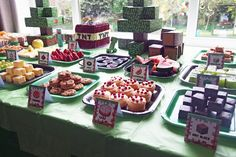 Minecraft party food with mini cakes and cake blocks.