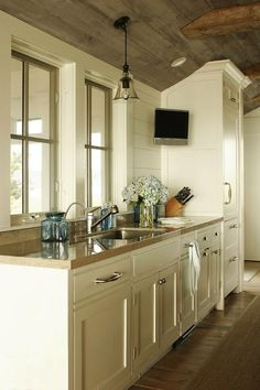 Shelter Interiors LLC: Beautiful country kitchen with cream kitchen cabinets paired with nickel hardware and ...
