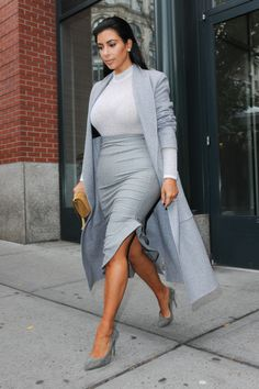 The maxi coat isn't what we'd call the easiest of trends, but being the good sport she is, Kim gave the look a go regardless. And it all paid off - with her slicked-back locks, the floor-skimming coat looks elegant, while the dove grey separates underneath tick the bodycon box once more.