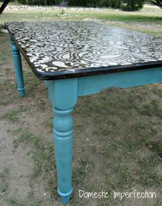 The blogger used a stencil for the huge design on top, and some dark stain for in between the paint. If you click the link it has her full tutorial! This will be my next project! Love this!!