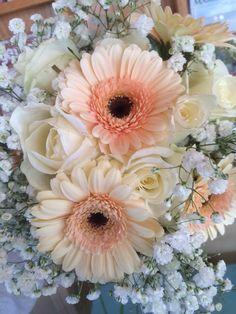 Wedding bouquet arrangement. Gerber daisies,roses, baby's breath.