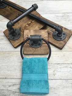 Industrial, rustic bathroom set of 3    DESCRIPTIONS: This industrial rustic bathroom set include bath towel holder, toilet paper holder and a hand towel ring. Industrial, rustic beautiful set of 3. It will make your bathroom outstanding and one of a kind. The wood is custom hand distressed. No two pieces are alike.  Its made out of pipes. Clean and protected for long lasting use. Easy to clean with damp clean cloth.  Its a great piece to any house. New and modern or old with character. Do…