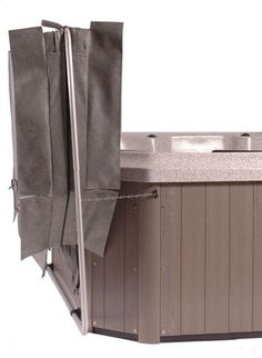 Lifts bulky hot tub cover with ease. Base of cabinet mount accommodates irregular shaped spas. Clearance for wall depends on cover size - typically 10-22 inches. Holds spa covers up to 96 inches.