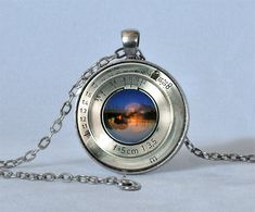VINTAGE CAMERA LENS Pendant Silver Blue Orange Camera Necklace Photography Pendant Photographer Gift  Camera Jewelry Not an Actual Lens. $14.25, via Etsy.