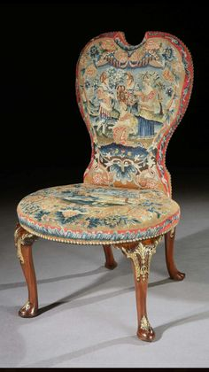 A PAIR OF GEORGE II PARCEL GILT MAHOGANY NEEDLEWORK SIDE CHAIRS ATTRIBUTED TO PETER ALEXANDER, ENGLAND, CA 1735