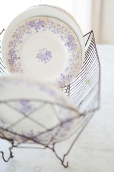 Antique French Lavender Transferware Plates. I like the idea of using an old dish rack for a buffet.