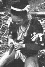 A Hanunóo boy of Mindoro carves letters into a piece of bamboo. A Hanunóo boy of Mindoro carves letters into a piece of bamboo. The Hanunóo script is one of three forms of the baybayin that is still in use today.