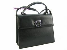 S.Ferragamo 2way Bag Black Pebble Leather With Silver hardware Good Condition  Ref-YLUE-2 Bangsar showroom + 6 010 220 3384 + 6 03 2095 6266 Bangsar Village showroom + 6 012 955 3384 + 6 03 2282 0066 Ampang showroom + 6 03 4251 0013 Email- luxuryvintagekl@gmail.com