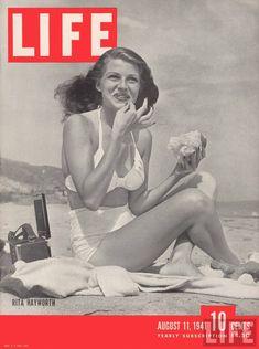 Original bombshell eating a burger? Love Rita Hayworth.