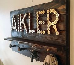 Custom word coat rack and key rack with shotgun shells, bullet casings, and railroad spikes