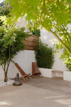 Japanese maples, stones and wood.  Contemporary patio by Laara Copley-Smith Garden & Landscape Design.