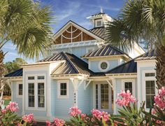 Our house inspiration, using this color, lighter metal roof, wide trim, blue beach house