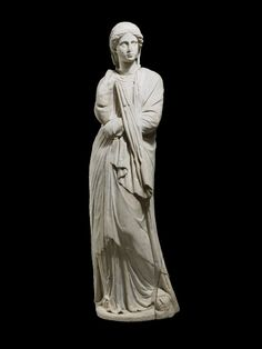 Parian marble figure of a draped woman, probably a private portrait. She wears a himation over a long chiton;