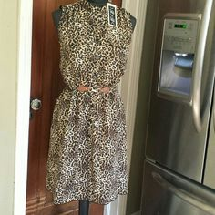 RNB leapord print dress Never worn, still has tags. Beautiful dress with a faux belt. This is not an actual belt but just a cute detail on the front. Sleeveless with twi false pockets on the chest. Dresses Midi
