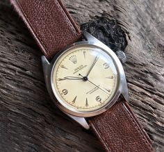 This is a Rolex Oyster Perpetual Chronometer from Champagne dial Ref. The high-grade calibre 630 movement was produced in it was also the last generation of the bubble back. Brushed and polished case l, Vintage Rolex, Vintage Watches, Vintage Men, Amazing Watches, Beautiful Watches, Fine Watches, Watches For Men, Wrist Watches, Luxury Watches