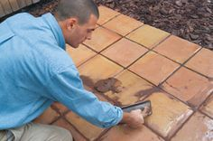 How to Lay Tile over Concrete  http://extremehowto.com/how-to-lay-tile-over-a-concrete-patio/