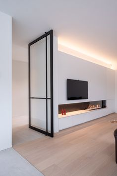 Pivoting room dividers with a minimal aluminium frame and invisible pivot hinges without any pre-installed parts inside floor or ceiling. Living Room Decor Fireplace, Fireplace Design, Living Room Interior, House Extension Design, House Design, Esstisch Design, Pivot Doors, Interior Stairs, House Inside