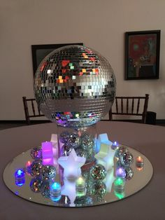 These mirror ball centerpieces were created for a disco-themed Bat Mitzvah. Disco Theme Parties, Disco Party Decorations, Disco Birthday Party, 70th Birthday Parties, Party Themes, Ideas Party, 1970s Party Theme, Table Decorations, Karaoke Party
