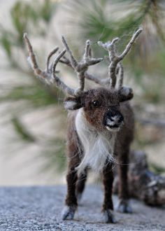 The reindeer is handmade by the needle felt soft sculpture technique. I created this little unique wool sculpture out of natural sheep and alpaca