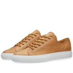 Continuing their quiet revolution on the world of overly branded footwear, the Tournament is back for the Common Projects SS'16 collection. Taking cues from some of the most iconic sporting footwear every produced, they have maintained both their unparalleled quality and their sole concession to branding, a simple style and size code stamped in gold at the heel.  Leather Uppers Trimmed Seams Gold Stamped Style Code at Heel Rubber Cup Sole Unit Made in Italy
