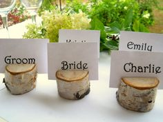 25 Charming Michigan Birch Wood Natural Wooden Place Card Holder Rounds for Weddings, Meetings, School Events, Artists, or Craft Shows. $29.50, via Etsy.