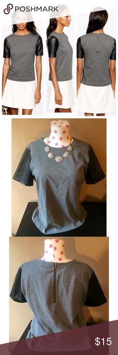 J Crew Tee with Leather Sleeves, size small J Crew Tee with Vegan Leather Sleeves, size small. This top is a fun, edgy twist on a classic grey T-shirt. It's so cute, and pairs well with colorful necklaces. Awesome with jeans or leggings! J. Crew Tops Tees - Short Sleeve