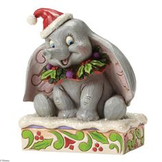 4051969 Sweet Snow Fall (Dumbo 75th Anniversary Piece)- Jim Shore celebrates the 75th anniversary of the Disney classic Dumbo with this unique design featuring the beloved baby elephant decked out for Christmas #Dumbo #JimShore #Disney